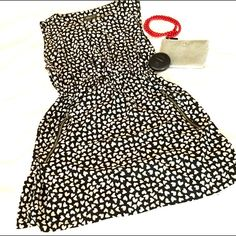 "listing Adorable!! B&W Heart Dress I love this. I love it so much that I'm iffy on selling it  :) It's a U.K. Size 16. I'm saying it'll fit a 10-12 best. Elastic waist and zippered pockets. (Love pockets on a dress that aren't bulky and weird!).  Bust 22"" length length 34.75"" 95% polyester 5% viscose. Feels like silk :) Apricot Dresses"