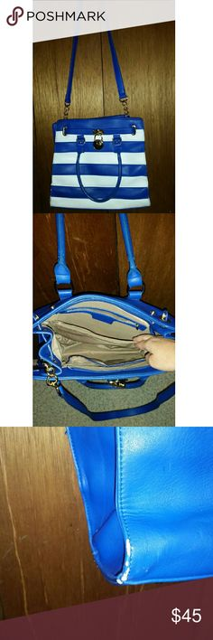 Blue and White Stripe Michael Kors purse This purse has a long shoulder strap that can come off and on, also the bottom backside has a small worn spot on both sides which I have a picture of. Has capartment inside. Michael Kors Bags Shoulder Bags
