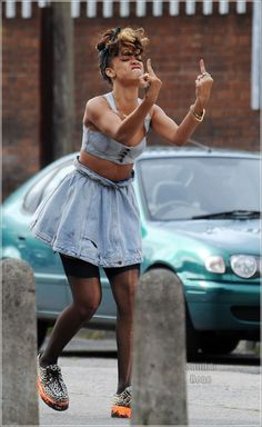 RIHANNA think she's having a bad day poor love,,,