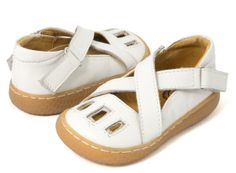 Luz White Toddler/Child  Inspired by a pair of Amie's grandfather's baptism shoes, these sandals are a precious memento reincarnated as a darling and contemporary Mary Jane. The little windows inspire the name – let the light shine in!