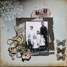 A Moment to Remember...this interesting heritage collage with a stencil, tags, layered ephemera and 'found objects' makes a charming layout.