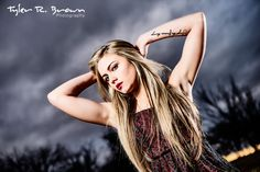 Kaity looks tough in this great photo of her showing her tattoo as a storm rolls through behind her.