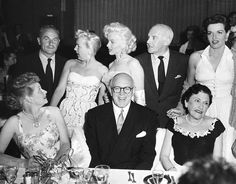 May 13, 1953 What an amazing picture Betty Grable, Marilyn Monroe, Walter Winchell, Jane Russell, Lucille Ball, Jimmy McHugh, and Louella Parsons at Walter Winchell's Birthday Party at Ciro's. The definition of Hollywood is this picture. Look at the expressions on their faces, the one who's laughing of course is a man ''Walter Winchell'' I would give anything to hear the dialog at this very moment ...Looks like a photo-bomb to me!