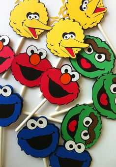Hey, I found this really awesome Etsy listing at http://www.etsy.com/listing/152346086/24-sesame-street-theme-cupcake-toppers