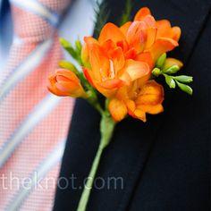 Orange freesia corsage