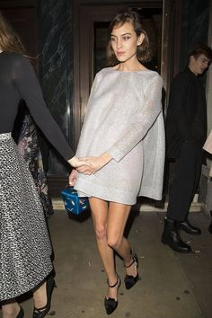Alexa Chung in Emilia Wickstead dress, Charlotte Olympia bag - 2014 British Fashion Awards After-Party in London.  (December 2014)