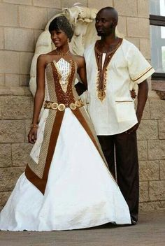 A-line wedding dress with gorgeous gold and brown prints. on The Fashion Time  http://thefashiontime.com/37-gorgeous-african-wedding-dresses/#sg20