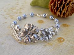 New to BeadsStory on Etsy: Rose Charm Bracelet Friendship bracelet Cuff Bangle Gift Baby Blue pearls Wedding jewelry USD