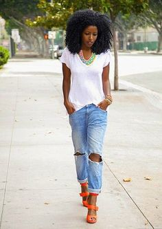 The easiest way to make boyfriend jeans look fancy? Add a bold necklace and heels.