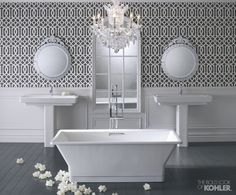 Fun patterned wallpaper in bathroom with free standing bathtub