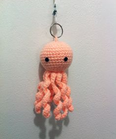 Peach color Octopus crochet keychain - idiot. It's obviously the head from a decapitated Ood.