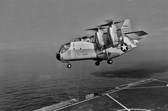 The Tri-Service Ling-Temco-Vought (LTV) experimental tilt wing aircraft takes off in helicopter fashion from the USS Ogden (LPD 5). The aircraft is designed to take off and land vertically like a helicopter and then fly forward like a conventional transport. The XC-142A is the largest U.S. vertical take-off and landing aircraft ever built, and the first built by this nation for operational evaluation rather than testing of a concept.