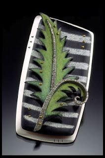 Deb Karash Jewelry........Connie Fox: Contrast between striped pattern and solid color. Contrast of shapes.