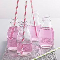 set of four milk bottles with straws by peach blossom   notonthehighstreet.com