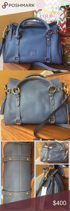 """Dooney & Bourke Dusty Blue Small Leather Satchel This is considered a """"small"""" bag for DB; however it's length measures at 12-13"""" so it's hardly what I would call """"small"""".  This bag is brand new with tags but traditionally super hard to find, sold out, and just a few hundred have recently been held by a large dept sold and sold out again.  This is one of those.  I want to keep but need holiday $, and I have an older one just like it.  The only bag I've owned that gets more beautiful with age…"""