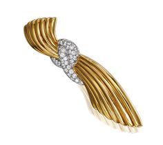 YELLOW GOLD AND DIAMOND BROOCH, VAN CLEEF & ARPELS, 1940S.  Of fluted design, set with circular- and brilliant-cut diamonds, signed V.C.A NY and numbered.
