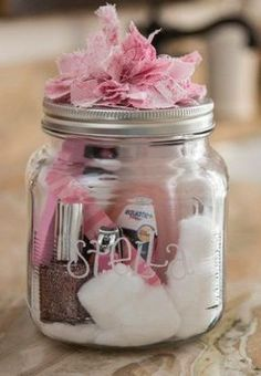 """""""You nailed it!"""" prizes. Winners of the games will each receive one of these. Includes a manicure set in a mason jar, decorated with a pink bow."""