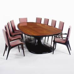 """VLADIMIR KAGAN SET OF FOURTEEN """"CONTOUR BACK"""" DINING CHAIRS comprising twelve sidechairs and two armchairs each branded KAGAN-DREYFUSS NEW YORK/A VLADIMIR KAGAN DESIGN walnut and upholstery 37 in. (93.9 cm) high ca. 1960 manufactured by Kagan-Dreyfuss, New York"""