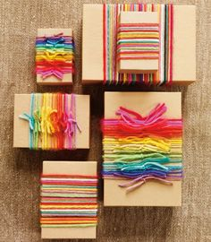 Dress up a brown paper package with yard:) Love the rainbow!