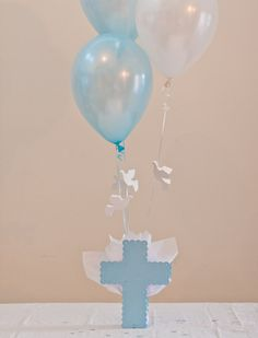 Our Cross Balloon Centerpieces with Flying Dove Balloons are the perfect Baptism table Decorations, Christening Decorations or Communion Christening Table Decorations, Boy Baptism Centerpieces, Communion Centerpieces, Communion Decorations, Balloon Centerpieces, Balloon Decorations, Shower Centerpieces, First Communion Party, Baptism Party