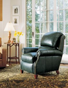 A fine top grain leather recliner like this will not only look amazing in any room, it will also feel amazing. You get to choose from a wide variety of top and full grain leathers as well as fabrics. The foot color and nail heads are also custom options you may consider. Visit the Stuart David website or factory showroom in Ceres, Ca to sit and fall madly in love with our fine recliners.