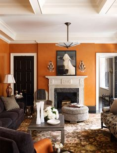 Burnt Orange Wall Over Fireplace A Living Room Decorated By Nick Olsen Photo Via Anik Pearson Architect