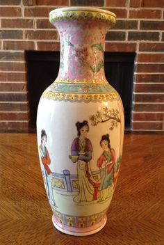 Offered is an Late Peoples Republic Period or PROC (c1949-1966) Chinese Rose Famille decorated porcelain vase, with a Qianlong period make red  115.00