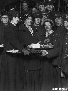 Women holding tray of tea