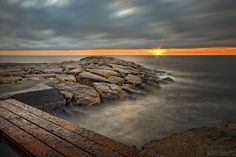sunrise on breakwater by dlddanilo