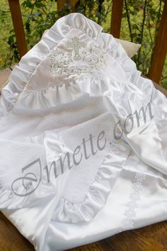 Hooded terrycloth christening towel  with silver embroidery. It is a magnificent christening towel of terrycloth on one side and satin fabric on the other. The internal part of a terrycloth christening towel is 100% cotton. There is a satin frill on the towel`s perimeter.  Its size is 90cm x 90cm. https://www.etsy.com/listing/264085790/white-christening-blanket-personalized?ref=shop_home_active_5 #christeningtowel #christeningblanket #baptismtowel