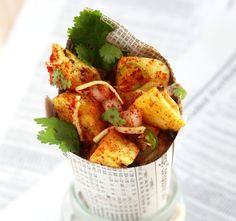 """Aloo Chaat. Indian street food. A boiled potato snack with Dhana Chutney, chillies and a mixture spices including """"Chaat Masala"""""""