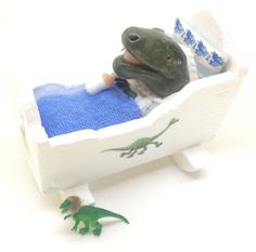 Baby T-Rex in miniature cradle  OOAK