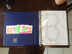 Letter/number binder with stickers