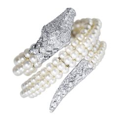 Cultured Pearl Diamond Platinum Snake Bangle Bracelet | From a unique collection of vintage bangles at https://www.1stdibs.com/jewelry/bracelets/bangles/