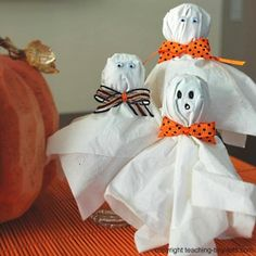 Halloween Lollipop Ghost made with Tootsie Roll Pops, Kleenex, and ribbon
