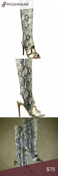 "$199 GUESS faux snakeskin sandal boots Brand new GUESS $199 faux snakeskin open toe & heel sandal knee high boots. Cutout detail at top of foot and back heel; fabric python printed upper with gold metallic straps and inside zip. Size 9. Included pic of Guess imprint on sole as proof of authenticity. 4.25"" heel 15.5"" shaft height 12"" shaft width. Guess Shoes Heeled Boots"