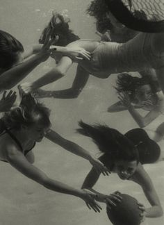 Peter Stackpole. Girl Getting Her Hair Pulled as Swimmers Play a Fast Scrimmage of Water Polo at Athletic Club.
