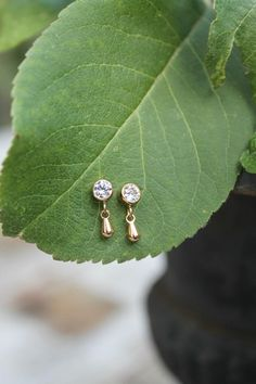 Cubic zirconia stud earrings with tiny dangle drops CZ post | Etsy Gold Ring Designs, Gold Bangles Design, Gold Jewellery Design, Jewelry Design Earrings, Gold Earrings Designs, Stud Earrings, Baby Earrings, Chandelier Earrings, Jewelry Box