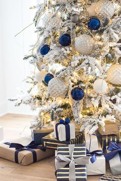 colorful christmas tree Friday Feels - Christmas Tree and Winter Boots - The Lilypad Cottage Frozen Christmas Tree, Blue Christmas Tree Decorations, Silver Christmas Tree, Christmas Mantels, Elegant Christmas, Beautiful Christmas, Christmas Themes, White Christmas, Vintage Christmas