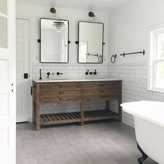 Gotta say that @kinkead_on_main knows how to bath time more fun! Love seeing our Vintage Pivot Mirror in this bathroom! Now if you excuse us, we need to take a bath! #bathroomdesign #blackandwhite #mypotterybarn