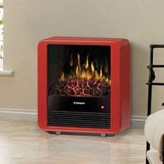 The Dimplex Mini Cube Freestanding Electric Stove - is unique, charming, and adds warmth and pizzazz to any room. Electric Fires, Electric Stove, Electric Fireplace Heater, Traditional Fireplace, Stove Fireplace, Camping Stove, Heating Systems, Small Appliances, Room Set