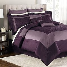 Love this deep purple.  Needs accent pillows that are the light cream color to break it up though, I think.
