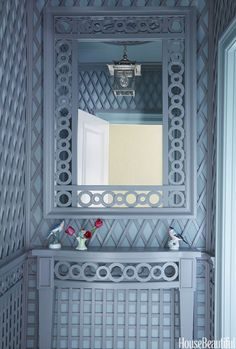 Chinoiserie meets orangery in the trellis-accented powder room, with millwork by Philippe Le Manach of Accents of France.