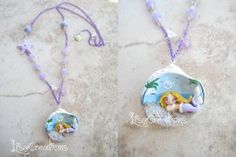 Violet mermaid in a shell by LisaCreations