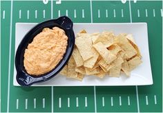 You're watching a football game and your favorite team scores. You want to scream and cheer, but that is hard with a mouth full of dry snacks. Instead
