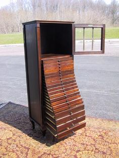 I tend to prefer MCM furniture, which this is not. BUT...I'm drooling at the storage possibilities in this baby!!! I could store all my silverware and serving pieces and some tableclothes in this!!!  Sheet music cabinet   Antique Mahogany Sheet Music Cabinet Tindale Cabinet Co Flushing NY