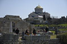 Putin puts Crimean site under federal control.  In this photo taken on Sunday, April 12, 2015, people gather at the area that was  the ancient Greek colony of Chersonesus, and with the St. Vladimir's Cathedral  in the background, just outside Sevastopol, the main port city in Crimea,  the Black Sea Peninsula annexed by Russia from Ukraine last year [Credit: Alexander Polegenko/AP]