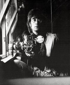 Self Portrait of John Lennon and his Rolleiflex in the attic of his house Kenwood, June 29, 1967.