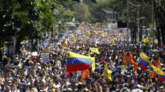 Opposition demonstrators take part in a protest against Venezuela's President Nicolas Maduro's government in Caracas. #12F