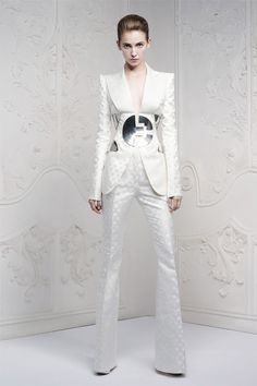 """Alexander McQueen Resort 2013 Sarah Burton's tableau mimicked the louche Seventies back cover of Bowie's """"Hunky Dory"""" album almost to the t. And the clothes hit a space age note of his other eras, too."""